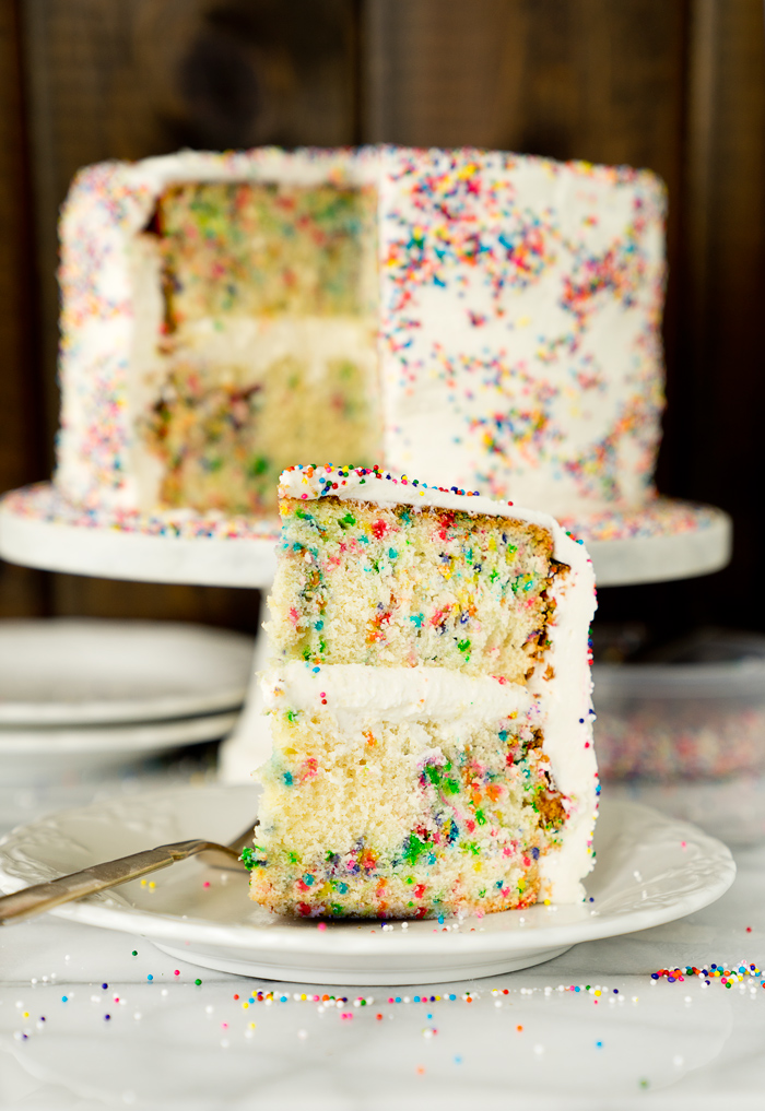 Super moist, buttery, yellow cake dotted with sprinkle. Classic, sweet and creamy buttercream frosting sprinkled with...well sprinkles.