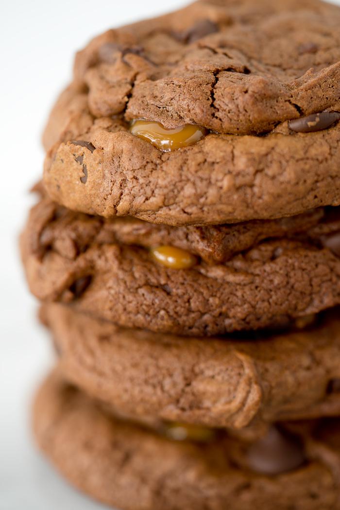 Dark Chocolate Caramel Stuffed Cookies. The best cookie recipe ever! Deep, dark chocolate. Gooey caramel and a sprinkling of flaky sea salt. | thesugarcoatedcottage.com