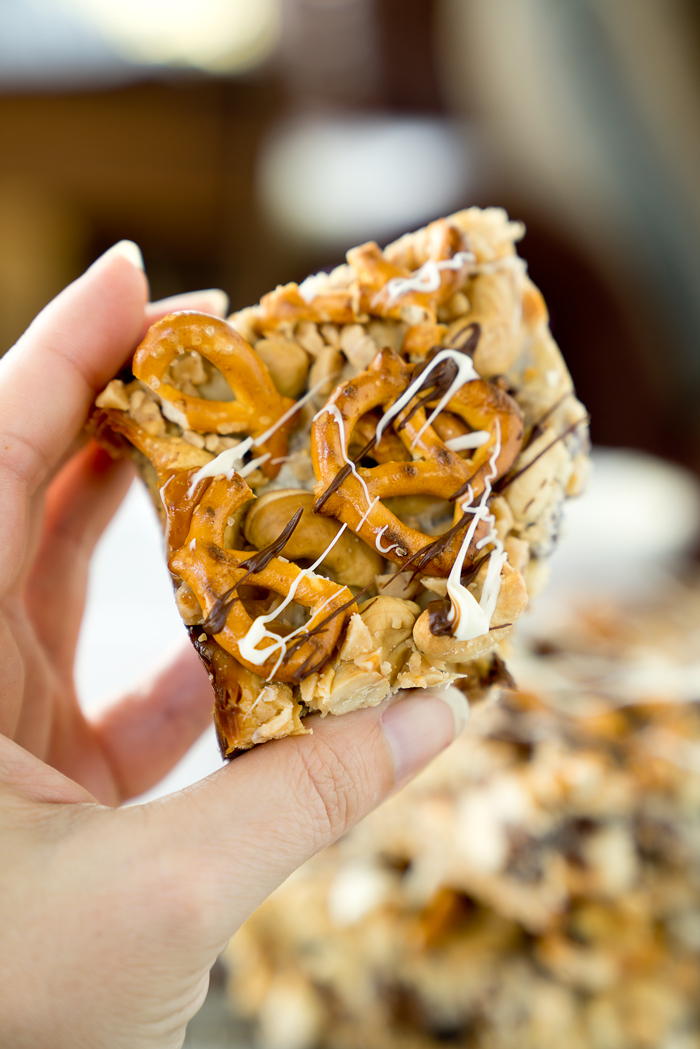 Magical Oatmeal Nutty Toffee Bar recipe. Oatmeal raisin base topped with pecans, walnuts, cashews, chocolate, toffee, coconut and pretzels! Trust me, you need these. | thesugarcoatedcottage.com