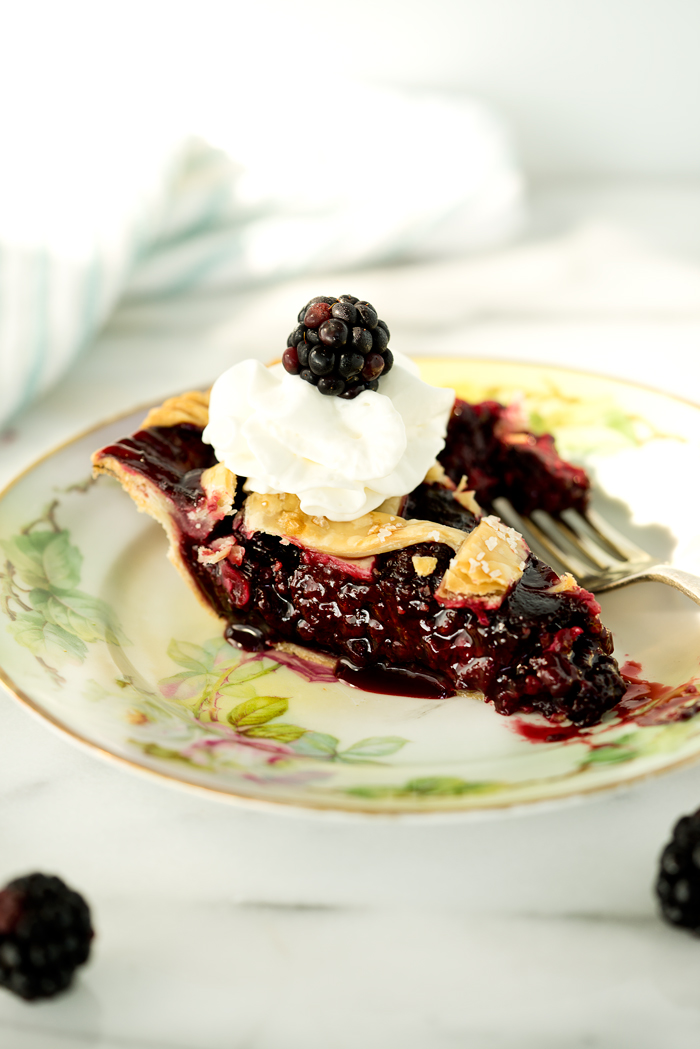 Scrumptious Black Berry Pie recipe! Plump, juicy, sweet, tart black berries gathered in a flaky, buttery, tender crust! | thesugarcoatedcottage.com