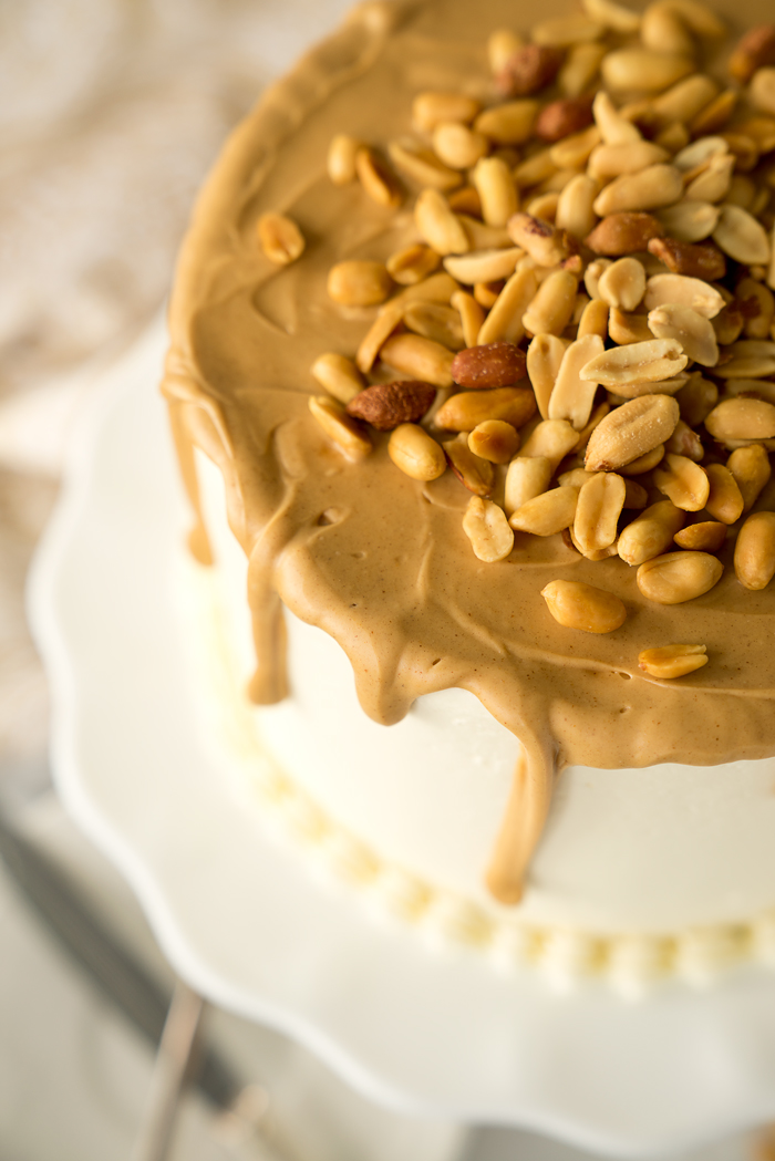 Dreamy White Chocolate Peanut Butter Cake Recipe. I'm in love with layers of white chocolate cake, white chocolate buttercream and creamy peanut butter ganache!! | thesugarcoatedcottage.com