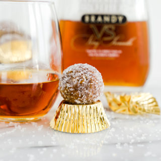 Brandy Pecan Ball Recipe. Need an awesome cookie to take to your next holiday gathering or maybe a cookie to snack on as the snow falls and you cuddle by the fireplace? Brandy Pecan Balls are the answer. | thesugarcoatedcottage.com