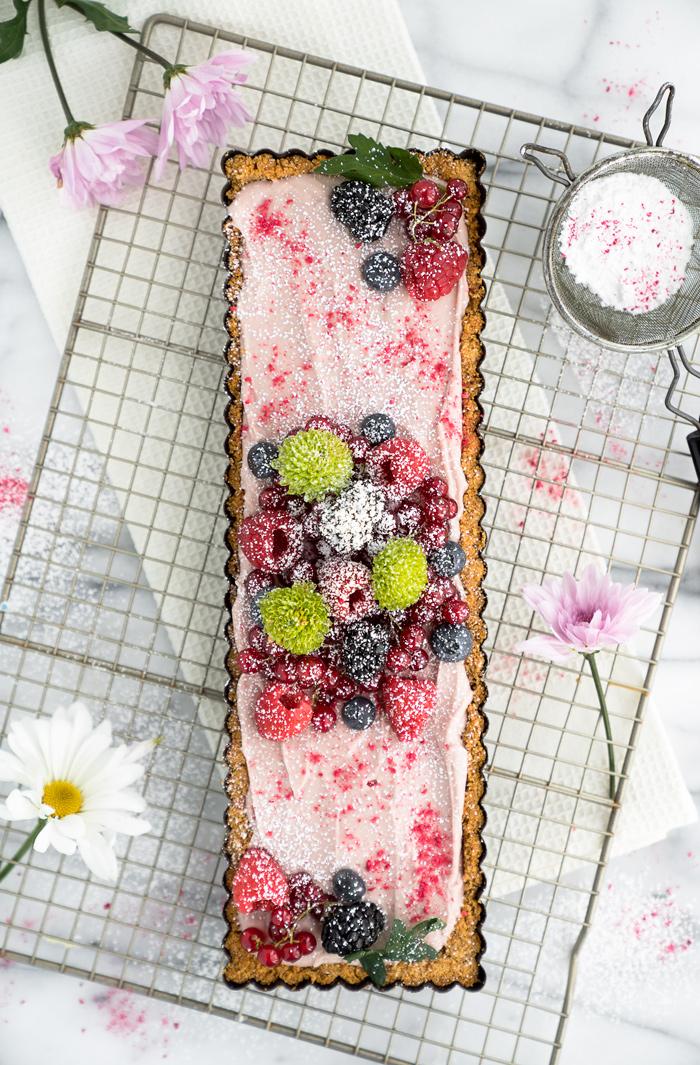 Raspberry Ganache Tart recipe. Smooth, rich and creamy raspberry ganache wrapped in a crunchy cookie crust.   thesugarcoatedcottage.com
