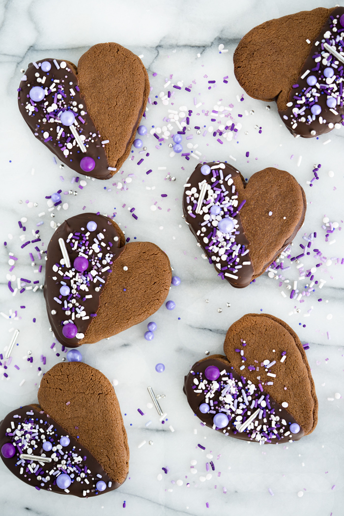 Double Chocolate Ganache Sandwich Cookie Recipe. Creamy chocolate ganache truffle filling sandwiched between two crispy chocolate cookies. Perfect for valentines day or any special occasion. | thesugarcoatedcottage.com