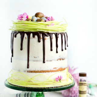 Vanilla Bean Layer Cake Recipe. 4 layers of the best vanilla bean enhanced cake smothered in a layer of vanilla bean buttercream. Perfect cake recipe for any occasion including birthdays, Easter, 4th of July, Christmas. | thesugarcoatedcottage.com @NielsenMassey