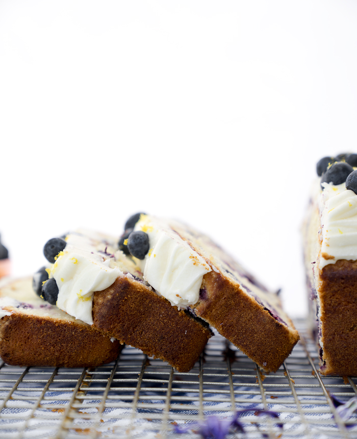 Cream Cheese Lemon Blueberry Pound Cake Recipe. Moist and creamy lemony pound cake studded with sweet plump blueberries. There is nothing like a great pound cake! | thesugarcoatedcottage.com #lemon #recipe #blueberry #cake #poundcake