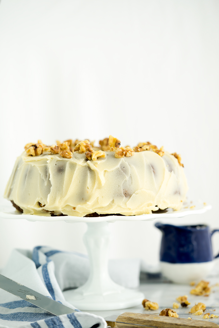 Rum Raisin Carrot Bundt Cake Recipe. Moist, dense, spiced carrot cake with spiced rum soaked raisins and buttery rum icing. The best carrot cake! | thesugarcoatedcottage.com #cake #carrotcake #bundtcake