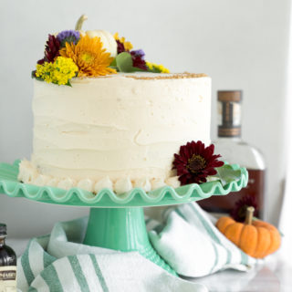 Pumpkin Cake with Salted Caramel Bourbon Buttercream. The only dessert you'll ever need this Thanksgiving. Perfectly spiced, unbelievable texture. | thesugarcoatedcottage.com