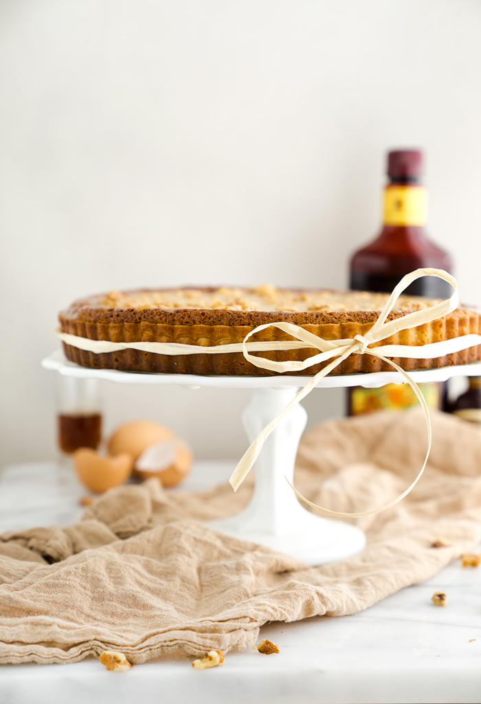 Walnut Rum Tart. Walnuts, salted caramel and rum all wrapped in a buttery crust. The filling is soft, delicate and crumbly. | thesugarcoatedcottage.com
