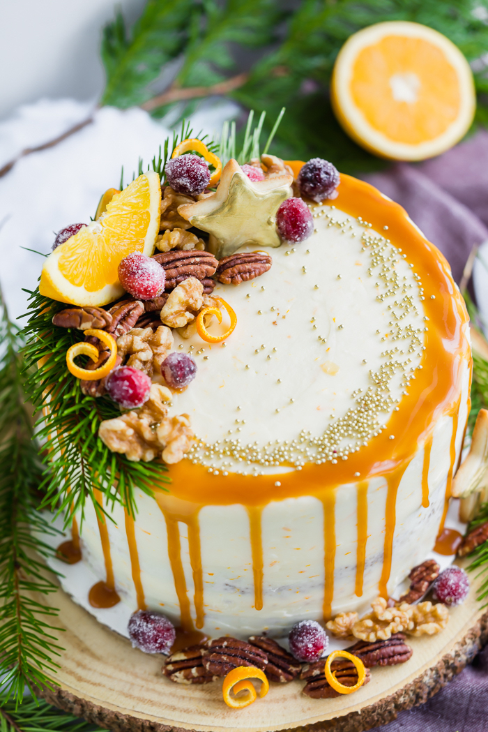 Gingerbread Orange Layer Cake. Three layers of orangey rum glazed gingerbread cake coated in an orangey cream cheese buttercream!! | gingerbread, cake