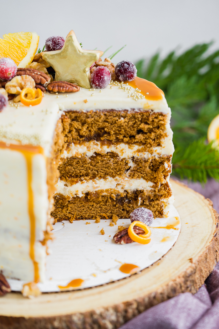Gingerbread Orange Layer Cake. Three layers of orangey rum glazed gingerbread cake coated in an orangey cream cheese buttercream!! | gingerbread, cake www. thesugarcoatedcottage.com