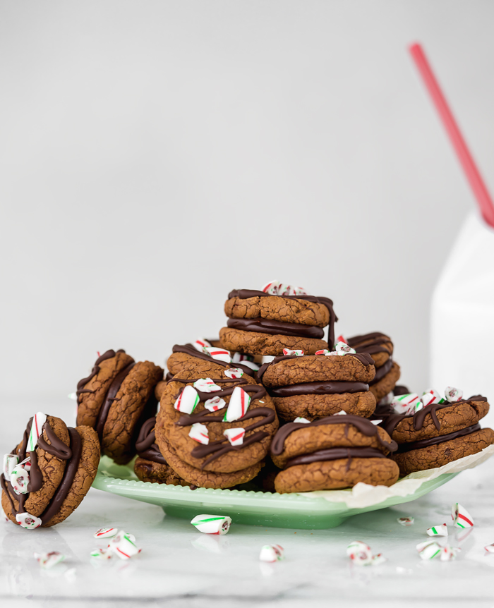Peppermint Ganache Sandwich Cookies. Crunchy on the outside, soft on the inside chocolate cookies sandwich smooth and creamy peppermint ganache! | www.thesugarcoatedcottage.com | @NielsenMassey, cookies, ganache, sandwich cookie, oreo, peppermint, holiday, christmas