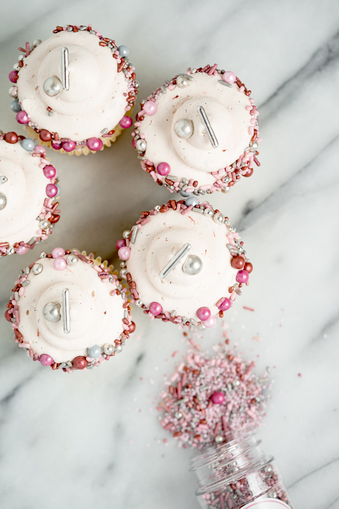 White Chocolate Strawberry filled cupcakes. White chocolate strawberry buttercream on top of a strawberry puree filled cupcake!! #cupcakes #buttercream   thesugarcoatedcottage.com