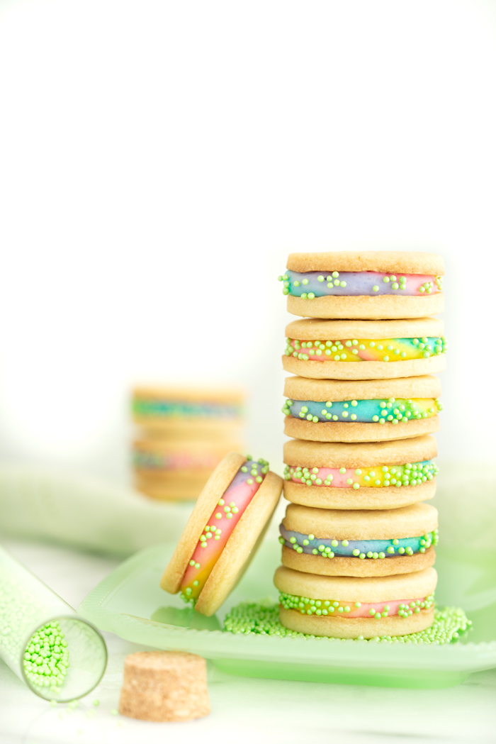 Buttercream Sandwich Cookie Recipe. Crispy sugar cookies sandwiching sweet buttercream. | thesugarcoatedcottage.com #cookies #buttercream #sandwich #rainbow