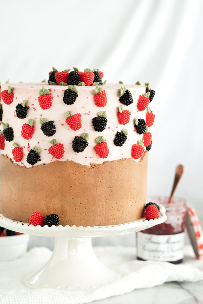Raspberry Chocolate Cake. Addicting layers of deep chocolate cake. Filled with raspberry and both raspberry and chocolate buttercream! #cake #buttercream