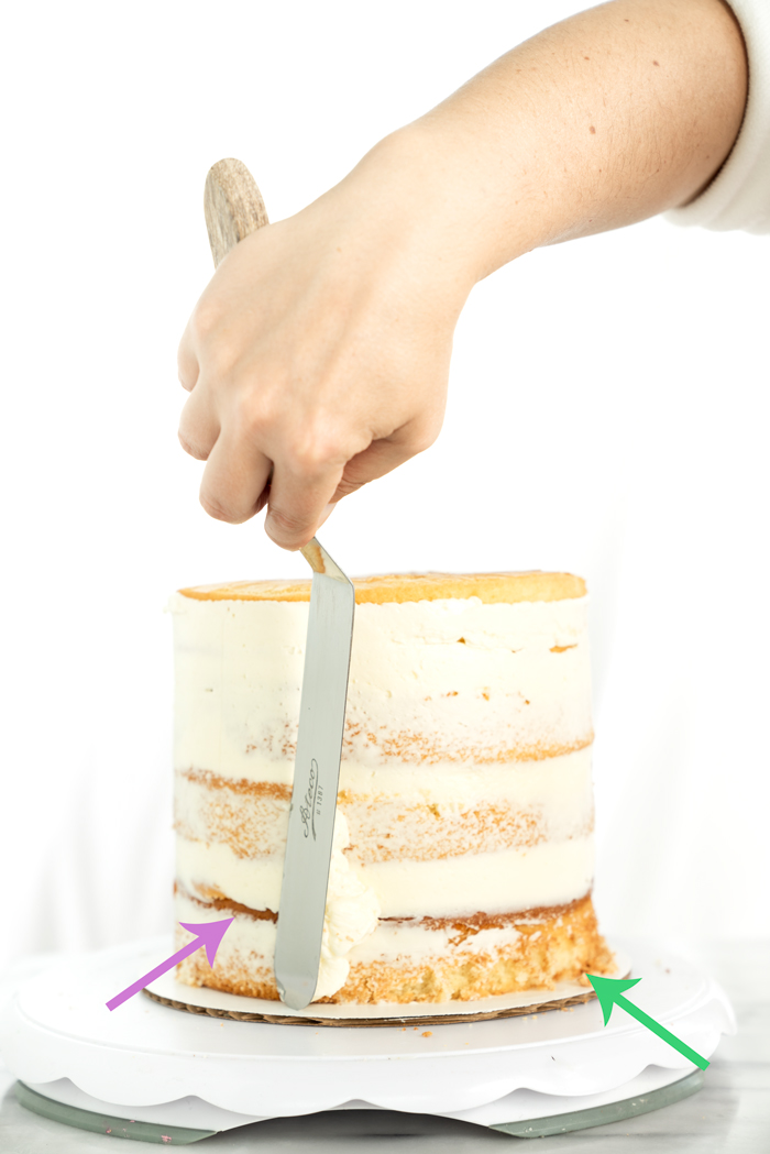 A step by step tutorial on how to properly fill and crumb coat a cake. thesugarcoatedcottage.com | #cake decorating, #crumb coat, #cake