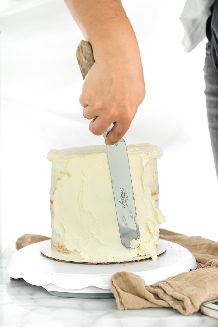 How To Create A Smooth Buttercream Finish. Step by step tutorial on how to get that coveted smooth buttercream finish. | thesugarcoatedcottage.com #cakedecoarting #buttercream #cake #dessert #recipe