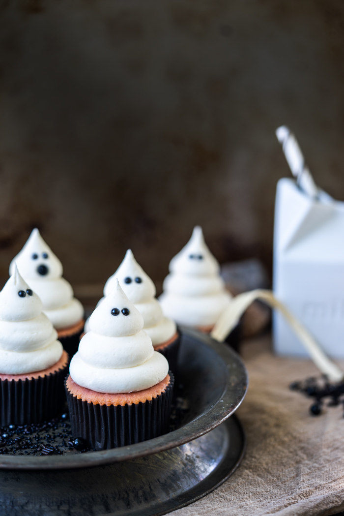 halloween ghost cupcakes with strawberry cupcakes and marshmallow buttercream