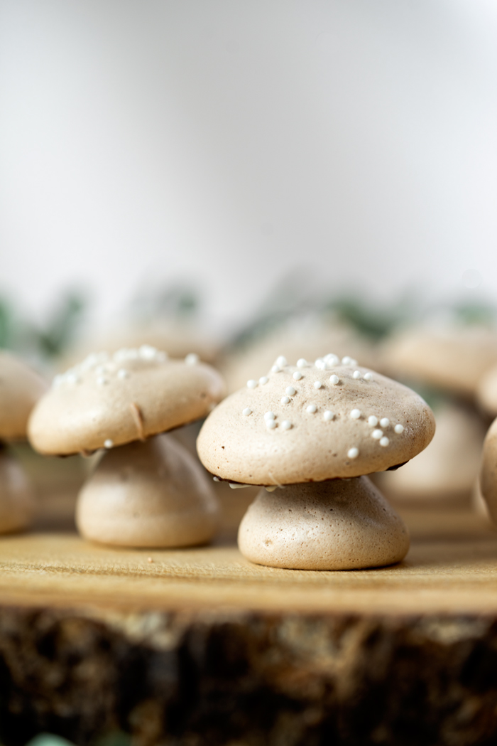 Sweet, edible, delicious meringue woodland mushrooms are great for decorating any dessert or to eat by themselves. #cakedecorating #meringuemushrooms