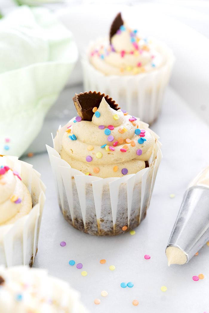 Banana Cupcakes with Peanut Butter Buttercream. Moist, delicious banana cupcakes and a swirl of peanut butter buttercream. #cupcake #banana #peanutbutter