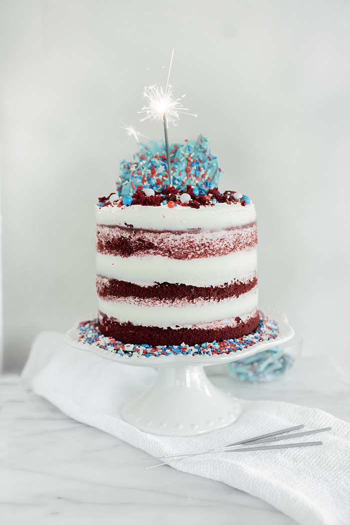 4th of July Red Velvet Cheesecake Cake. Moist, tender crumb red velvet cake with layers of whipped cheesecake filling. #4thofjuly #redvelvet #cheesecake
