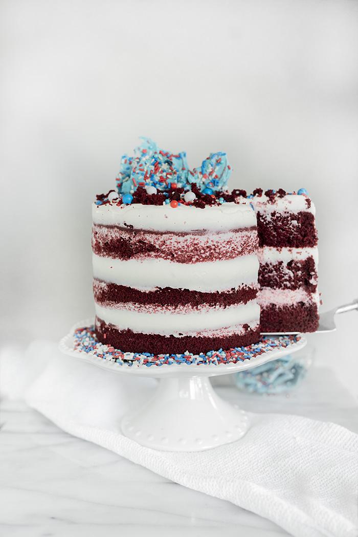 4th of July Red Velvet Cheesecake Cake. Moist, tender crumb red velvet cake with layers of whipped cheesecake filling. #4thofjuly #redvelvet #cheesecake #cake #redvelvetcheesecake