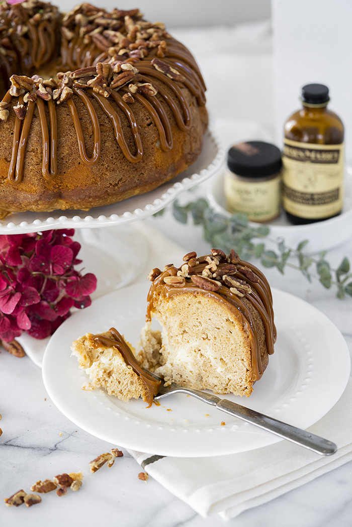 The Best Apple Spice Bundt Cake with Cream Cheese Filling and Dulce De Leche Glaze. | thesugarcoatedcottage.com #bundtcake #applecake #creamcheesefilling